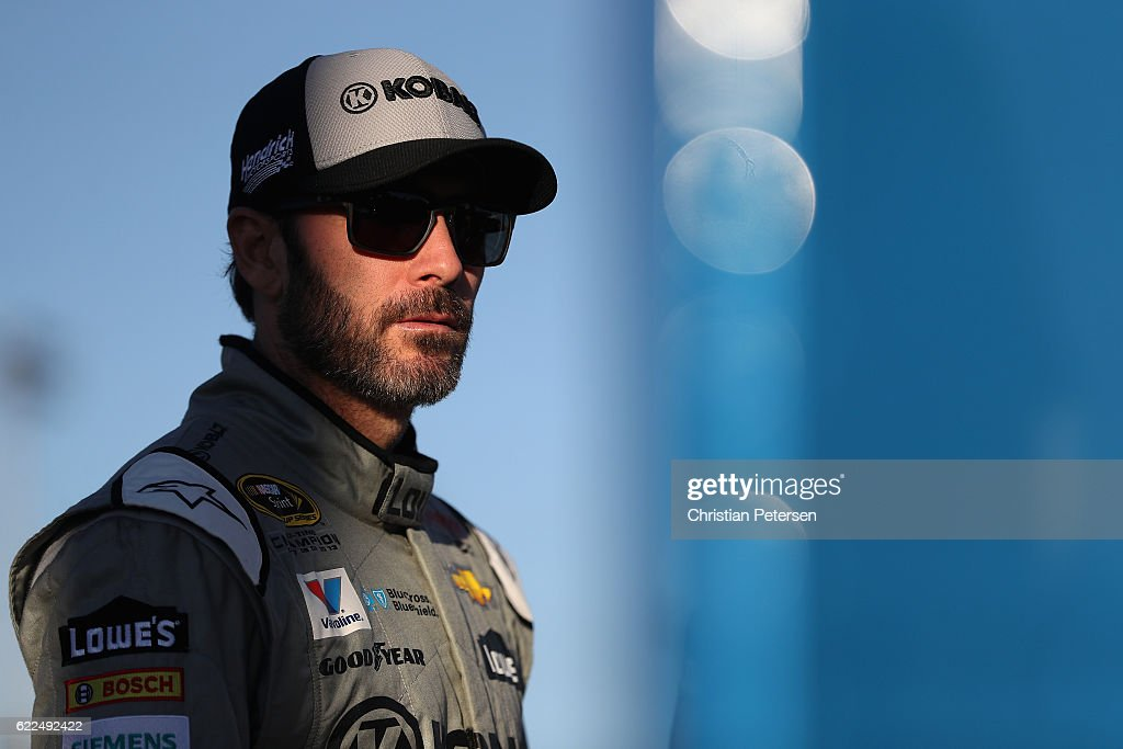Jimmie Johnson, driver of the #48 Kobalt Chevrolet, stands on the grid during qualifying for the NASCAR Sprint Cup Series Can-Am 500 at Phoenix International Raceway on November 11, 2016 in Avondale, Arizona.