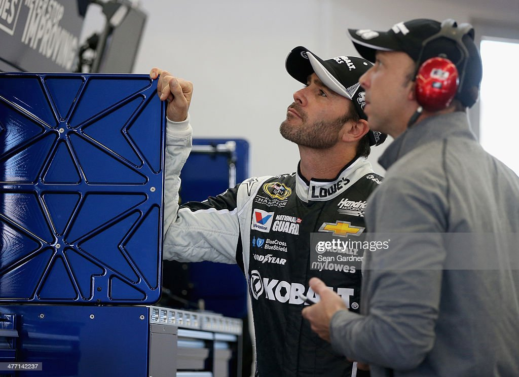 Jimmie Johnson (left), driver of the #48 Kobalt Tools Chevrolet, looks on with his crew chief Chad Knaus in the garage area during practice for the NASCAR Sprint Cup Series Kobalt 400 at Las Vegas Motor Speedway on March 7, 2014 in Las Vegas, Nevada.