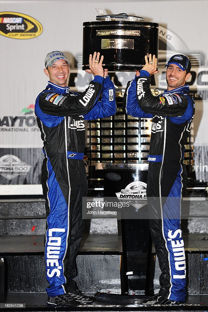 Jimmie Johnson, driver of the #48 Lowe's Chevrolet, and crew chief Chad Knaus hoist the Harley J. Earl trophy in Victory Lane after winning the NASCAR Sprint Cup Series Daytona 500 at Daytona International Speedway on February 24, 2013 in Daytona Beach, Florida.