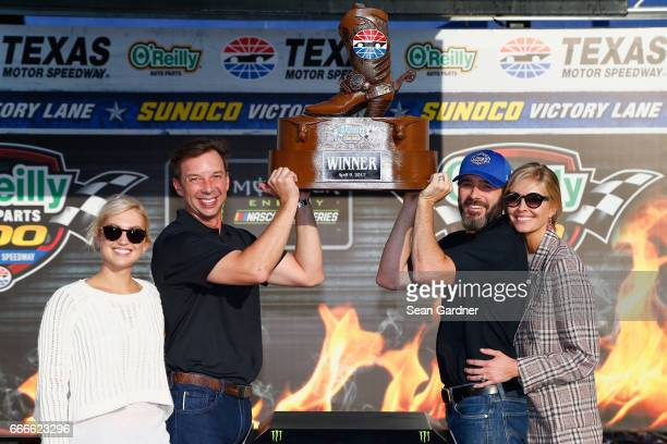 Jimmie Johnson driver of the Lowe's Chevrolet and crew chief Chad Knaus pose with their wives Chandra Janway and Brooke Werner in Victory Lane after...
