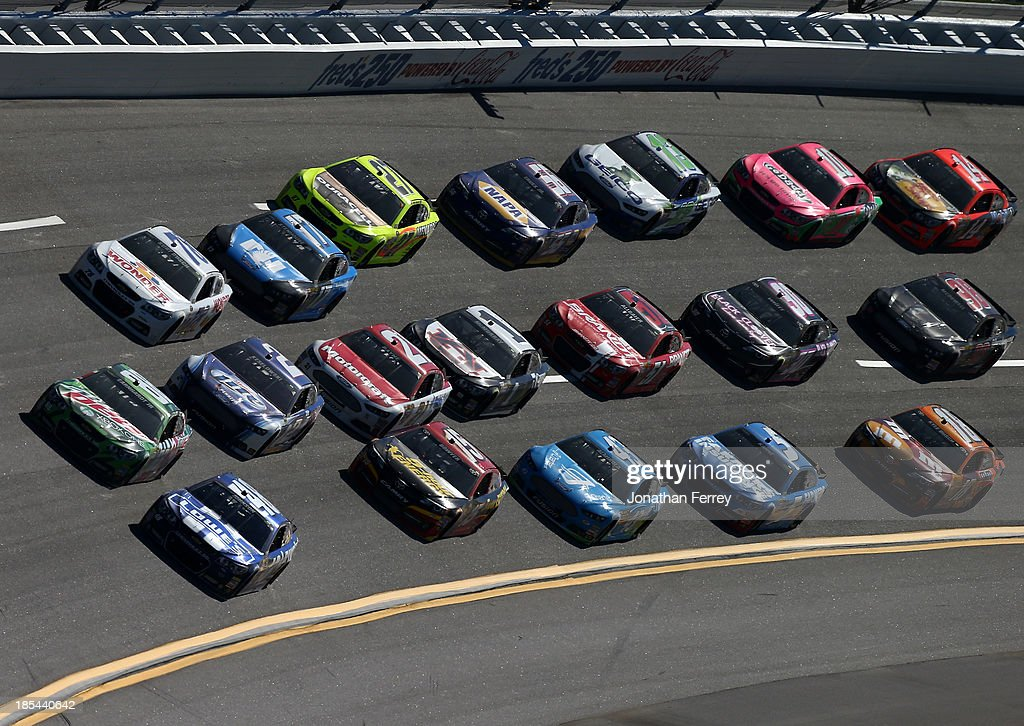 Jimmie Johnson, driver of the #48 Lowe's Chevrolet, and Dale Earnhardt Jr., driver of the #88 Mountain Dew / XBox One Chevrolet, lead a pack of cars during the NASCAR Sprint Cup Series Camping World RV Sales 500 at Talladega Superspeedway on October 20, 2013 in Talladega, Alabama.