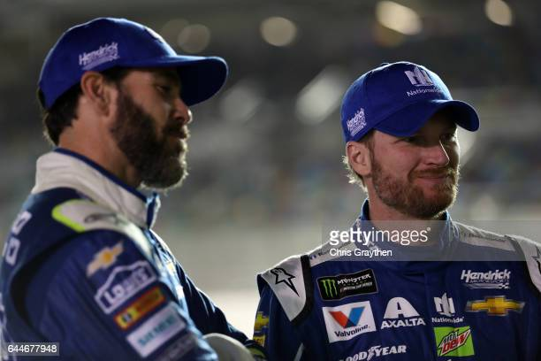 Jimmie Johnson driver of the Lowe's Chevrolet and Dale Earnhardt Jr driver of the Nationwide Chevrolet talk prior to the Monster Energy NASCAR Cup...