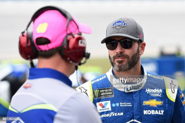 Jimmie Johnson driver of the Lowe's Chevrolet and his crew chief Chad Knaus stand on the grid during qualifying for the Monster Energy NASCAR Cup...