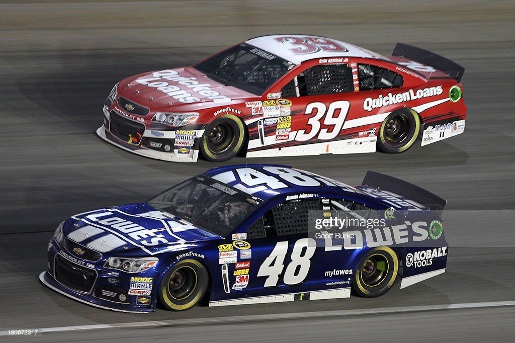 Jimmie Johnson, driver of the #48 Lowe's Chevrolet, and Ryan Newman, driver of the #39 Quicken Loans Chevrolet, during the NASCAR Sprint Cup Series Geico 400 at Chicagoland Speedway on September 15, 2013 in Joliet, Illinois.