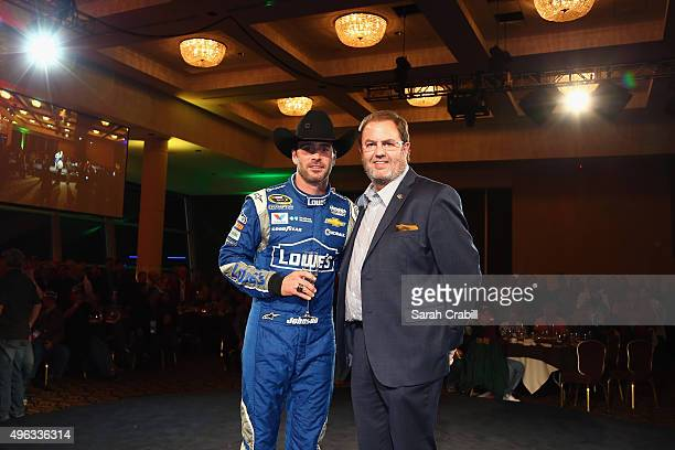 Jimmie Johnson driver of the Lowe's Chevrolet and Texas Motor Speedway President Eddie Gossage attend the Winner's Champagne Toast after the NASCAR...