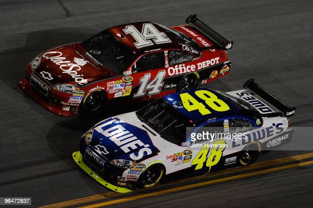 Jimmie Johnson driver of the Lowe's Chevrolet and Tony Stewart driver of the Old Spice Chevrolet race during the Budweiser Shootout at Daytona...