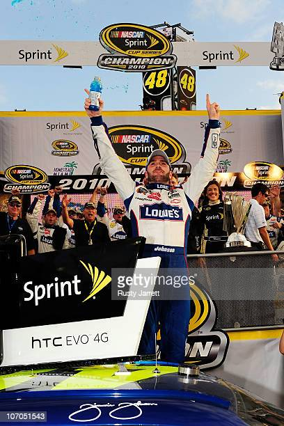 Jimmie Johnson driver of the Lowe's Chevrolet celebrates after finishing in second place in the Ford 400 to clinch his fifth consecutive NASCAR...