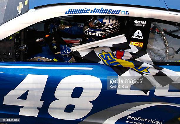 Jimmie Johnson driver of the Lowe's Chevrolet celebrates after winning the NASCAR Sprint Cup Series Folds of Honor QuikTrip 500 at Atlanta Motor...