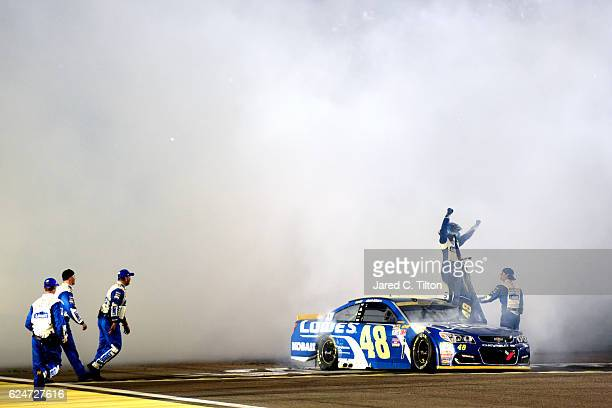Jimmie Johnson driver of the Lowe's Chevrolet celebrates after winning the NASCAR Sprint Cup Series Ford EcoBoost 400 and the 2016 NASCAR Sprint Cup...