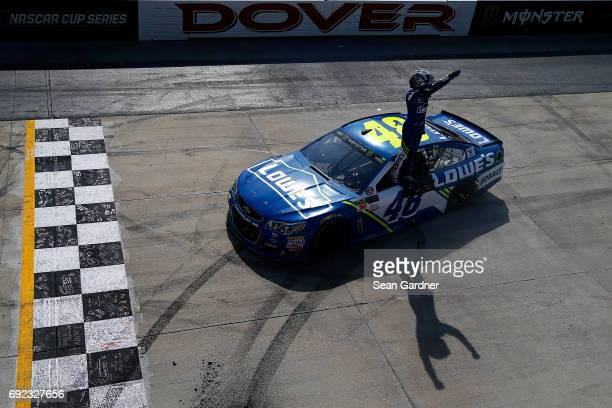 Jimmie Johnson driver of the Lowe's Chevrolet celebrates after winning the Monster Energy NASCAR Cup Series AAA 400 Drive for Autism at Dover...