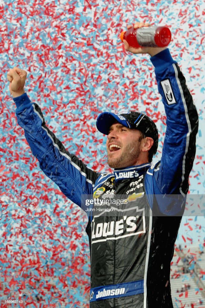 Jimmie Johnson, driver of the #48 Lowe's Chevrolet, celebrates in Victory Lane after winning the NASCAR Sprint Cup Series STP Gas Booster 500 on April 7, 2013 at Martinsville Speedway in Ridgeway, Virginia.
