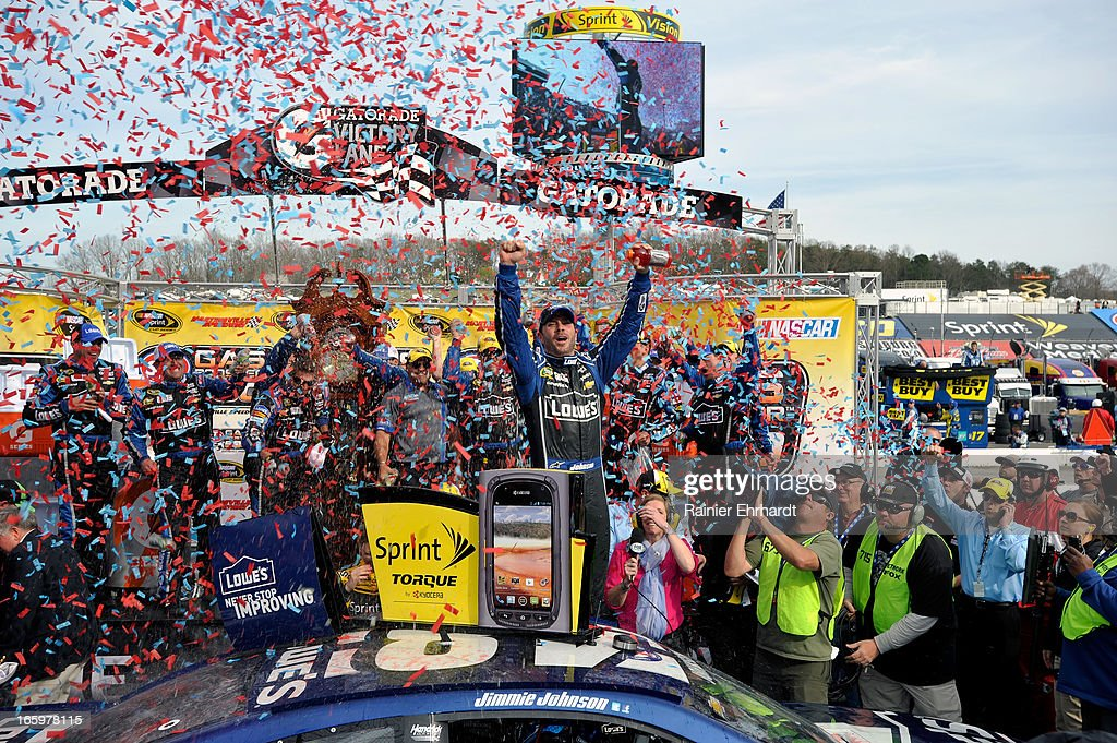 <a gi-track='captionPersonalityLinkClicked' href=/galleries/search?phrase=Jimmie+Johnson+-+Nascar+Race+Driver&family=editorial&specificpeople=171519 ng-click='$event.stopPropagation()'>Jimmie Johnson</a>, driver of the #48 Lowe's Chevrolet, celebrates in Victory Lane after winning the NASCAR Sprint Cup Series STP Gas Booster 500 on April 7, 2013 at Martinsville Speedway in Ridgeway, Virginia.