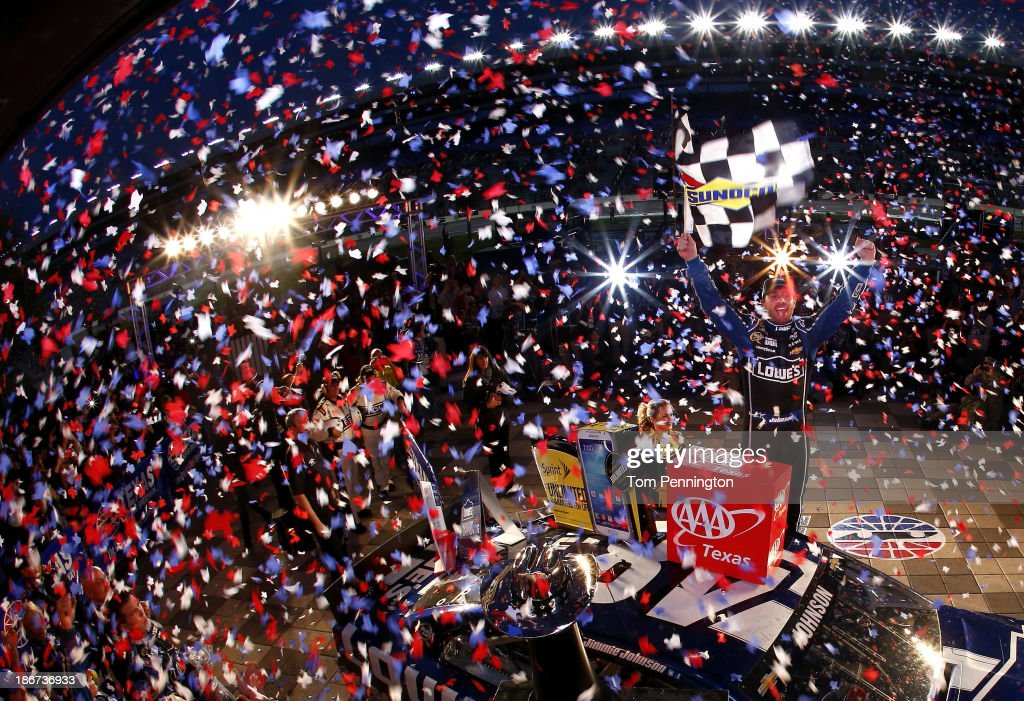 Jimmie Johnson, driver of the #48 Lowe's Chevrolet, celebrates in victory lane after winning the NASCAR Sprint Cup Series AAA Texas 500 at Texas Motor Speedway on November 3, 2013 in Fort Worth, Texas.