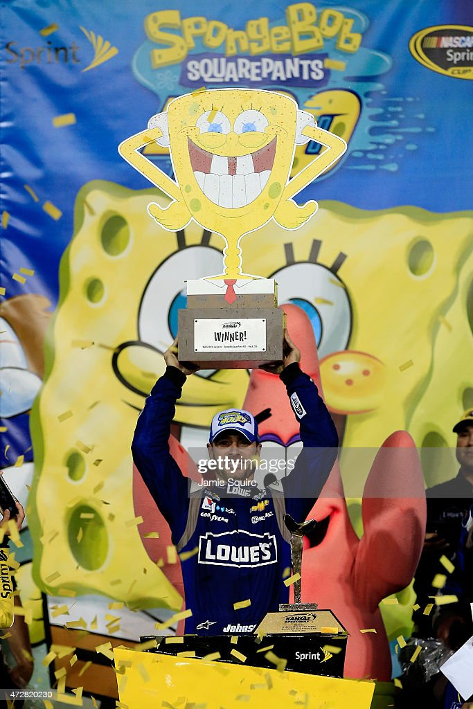 Jimmie Johnson, driver of the #48 Lowe's Chevrolet, celebrates in Victory Lane after winning the NASCAR Sprint Cup Series SpongeBob SquarePants 400 at Kansas Speedway on May 9, 2015 in Kansas City, Kansas.