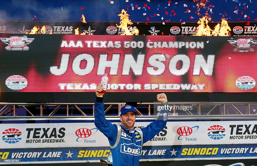 Jimmie Johnson, driver of the #48 Lowe's Chevrolet, celebrates in victory lane after winning the NASCAR Sprint Cup Series AAA Texas 500 at Texas Motor Speedway on November 8, 2015 in Fort Worth, Texas.