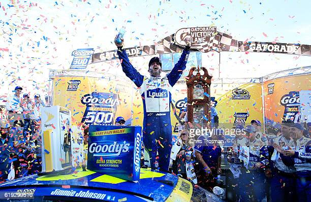 Jimmie Johnson driver of the Lowe's Chevrolet celebrates in Victory Lane after winning the NASCAR Sprint Cup Series Goody's Fast Relief 500 at...