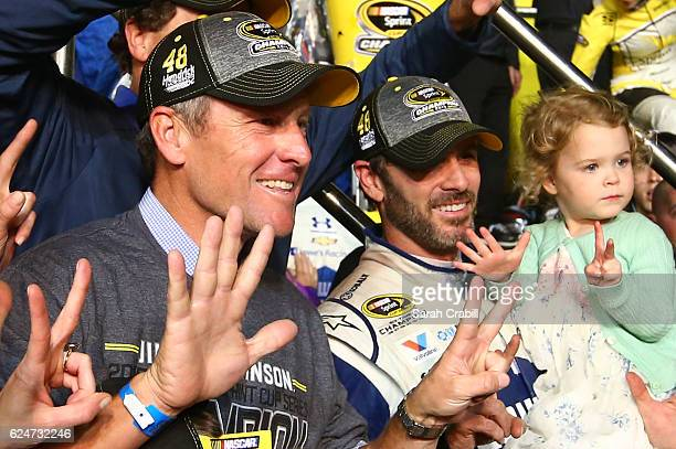 Jimmie Johnson driver of the Lowe's Chevrolet celebrates in Victory Lane with former professional road racing cyclist Lance Armstrong after winning...