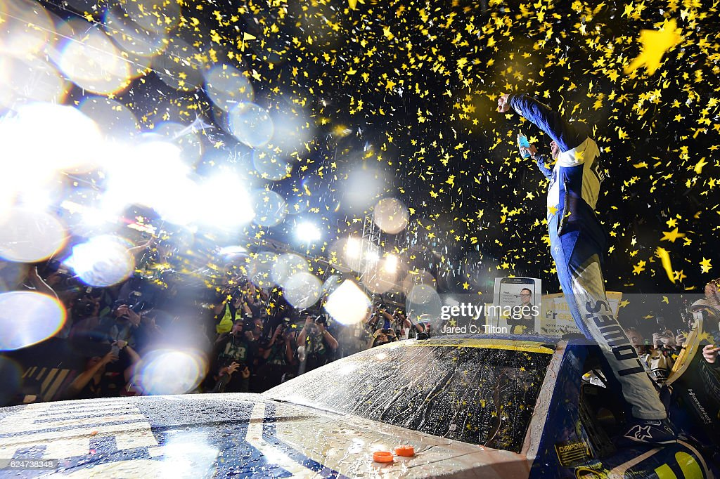 Jimmie Johnson, driver of the #48 Lowe's Chevrolet, celebrates in Victory Lane after winning the NASCAR Sprint Cup Series Ford EcoBoost 400 and the 2016 NASCAR Sprint Cup Series Championship at Homestead-Miami Speedway on November 20, 2016 in Homestead, Florida. Johnson wins a record-tying 7th NASCAR title.