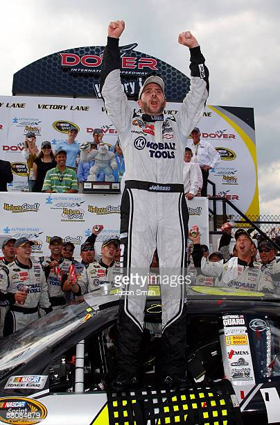 Jimmie Johnson driver of the Lowe's Chevrolet celebrates in victory lane after winning the NASCAR Sprint Cup Series Autism Speaks 400 at Dover...