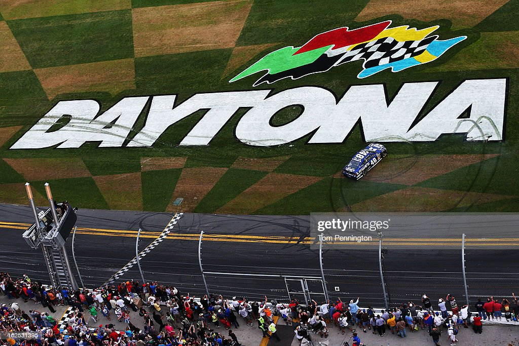 Jimmie Johnson, driver of the #48 Lowe's Chevrolet, celebrates winning the NASCAR Sprint Cup Series Daytona 500 at Daytona International Speedway on February 24, 2013 in Daytona Beach, Florida.