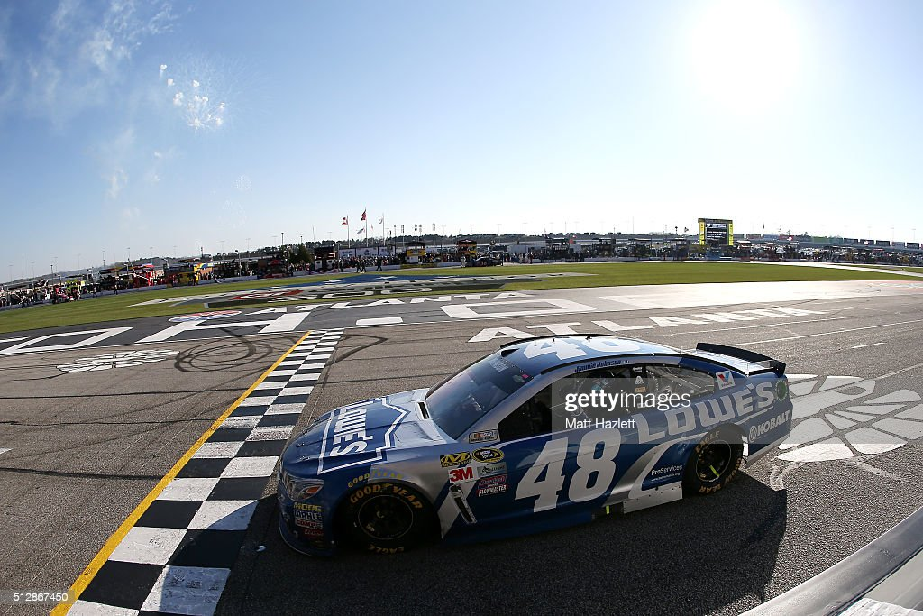 jimmie johnson driver of the 48 lowe 39 s chevrolet celebrates winning. Cars Review. Best American Auto & Cars Review