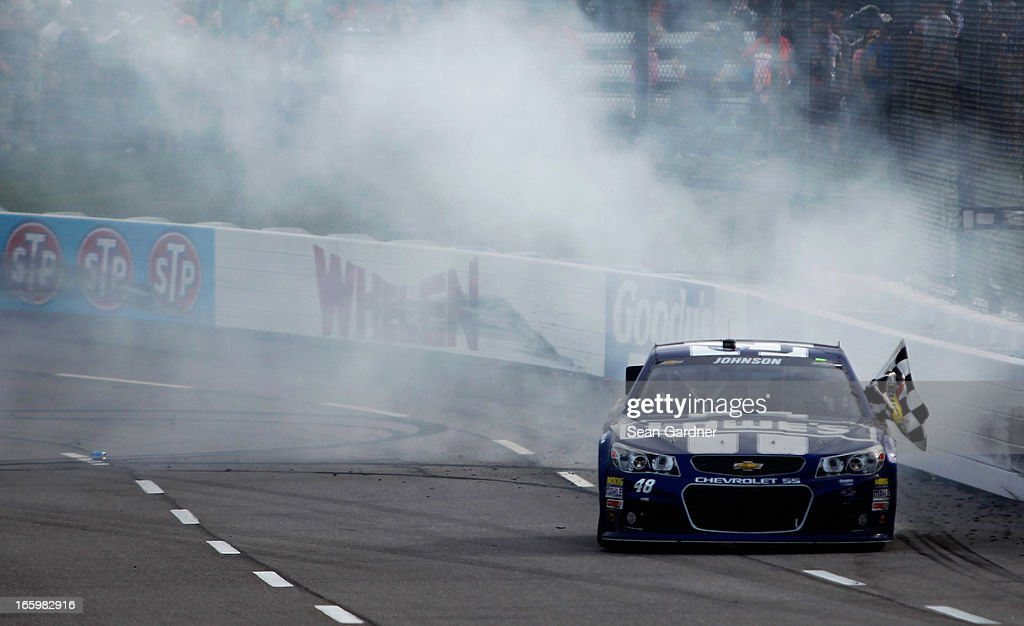 Jimmie Johnson, driver of the #48 Lowe's Chevrolet, celebrates with a burnout after winning the NASCAR Sprint Cup Series STP Gas Booster 500 on April 7, 2013 at Martinsville Speedway in Ridgeway, Virginia.