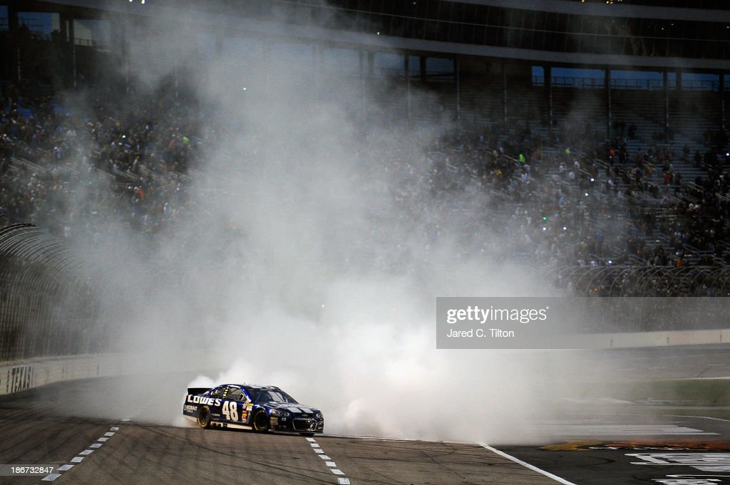 Jimmie Johnson, driver of the #48 Lowe's Chevrolet, celebrates with a burnout after winning the NASCAR Sprint Cup Series AAA Texas 500 at Texas Motor Speedway on November 3, 2013 in Fort Worth, Texas.
