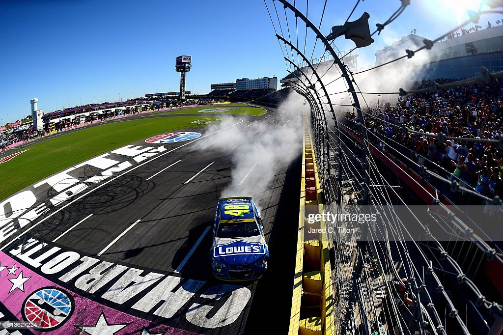 Jimmie Johnson, driver of the #48 Lowe's Chevrolet, celebrates with a burnout after winning the NASCAR Sprint Cup Series Bank of America 500 at Charlotte Motor Speedway on October 9, 2016 in Charlotte, North Carolina.