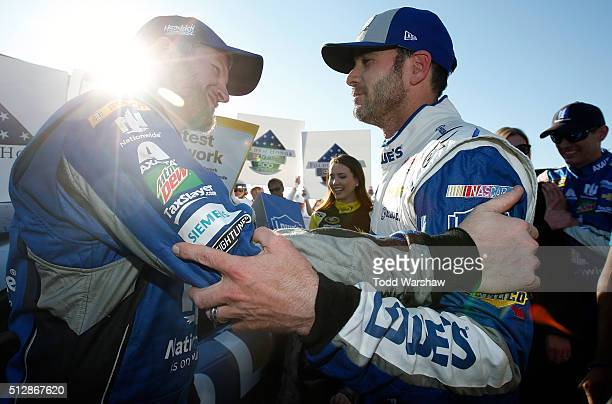 Jimmie Johnson driver of the Lowe's Chevrolet celebrates with Dale Earnhardt Jr driver of the Nationwide Chevrolet in Victory Lane after winning the...