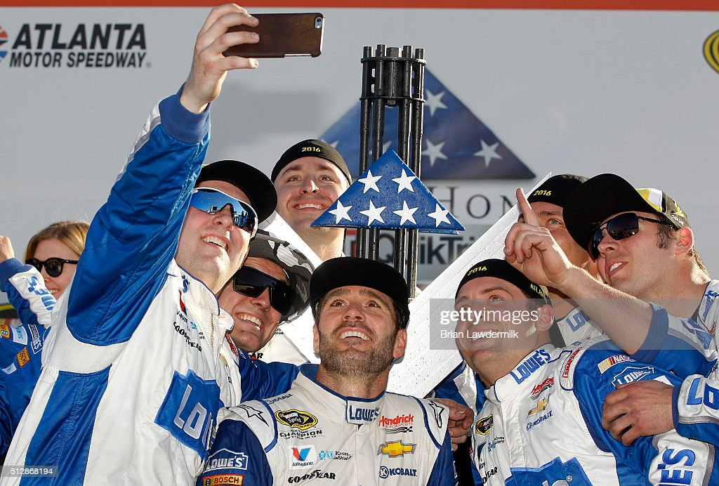 Jimmie Johnson, driver of the #48 Lowe's Chevrolet, celebrates with his crewmembers in Victory Lane after winning the NASCAR Sprint Cup Series Folds of Honor QuikTrip 500 at Atlanta Motor Speedway on February 28, 2016 in Hampton, Georgia.