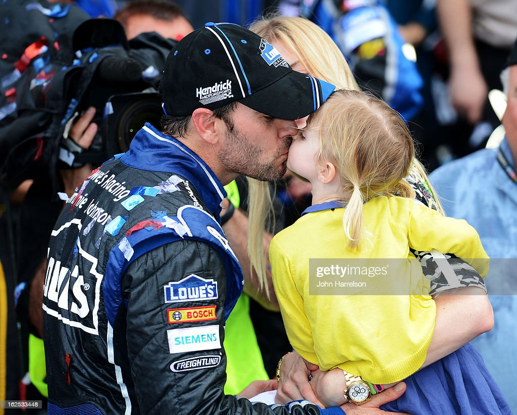 Jimmie Johnson, driver of the #48 Lowe's Chevrolet, celebrates with his daughter Genevieve Marie after winning the NASCAR Sprint Cup Series Daytona 500 at Daytona International Speedway on February 24, 2013 in Daytona Beach, Florida.