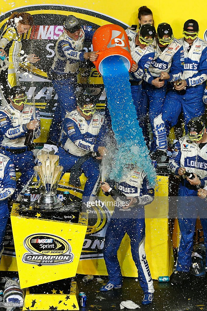 Jimmie Johnson, driver of the #48 Lowe's Chevrolet, celebrates with his team in Victory Lane after winning the NASCAR Sprint Cup Series Ford EcoBoost 400 and the 2016 NASCAR Sprint Cup Series Championship at Homestead-Miami Speedway on November 20, 2016 in Homestead, Florida. Johnson wins a record-tying 7th NASCAR title.