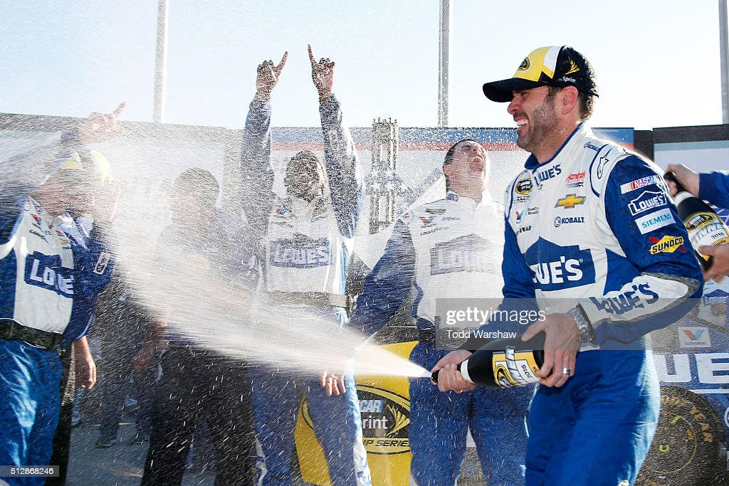 Jimmie Johnson, driver of the #48 Lowe's Chevrolet, celebrates with champagne in Victory Lane after winning the NASCAR Sprint Cup Series Folds of Honor QuikTrip 500 at Atlanta Motor Speedway on February 28, 2016 in Hampton, Georgia.