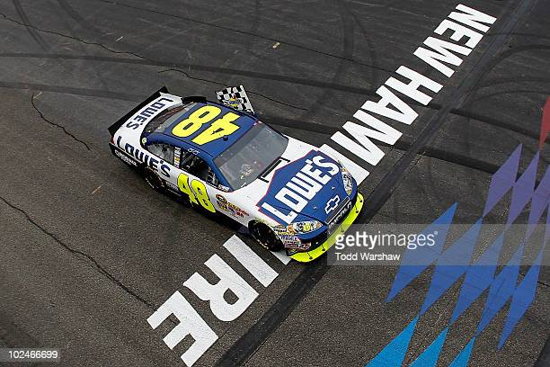 Jimmie Johnson driver of the Lowe's Chevrolet celebrates with the checkered flag after winning the NASCAR Sprint Cup Series LENOX Industrial Tools...