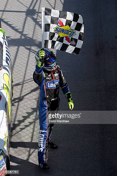 Jimmie Johnson driver of the Lowe's Chevrolet celebrates with the checkered flag after winning the NASCAR Sprint Cup Series Aaron's 499 at Talladega...