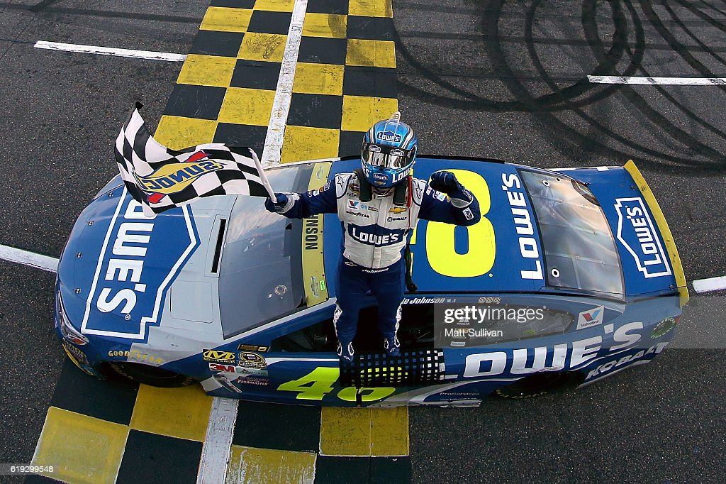 Jimmie Johnson, driver of the #48 Lowe's Chevrolet, celebrates with the checkered flag after winning the NASCAR Sprint Cup Series Goody's Fast Relief 500 at Martinsville Speedway on October 30, 2016 in Martinsville, Virginia.
