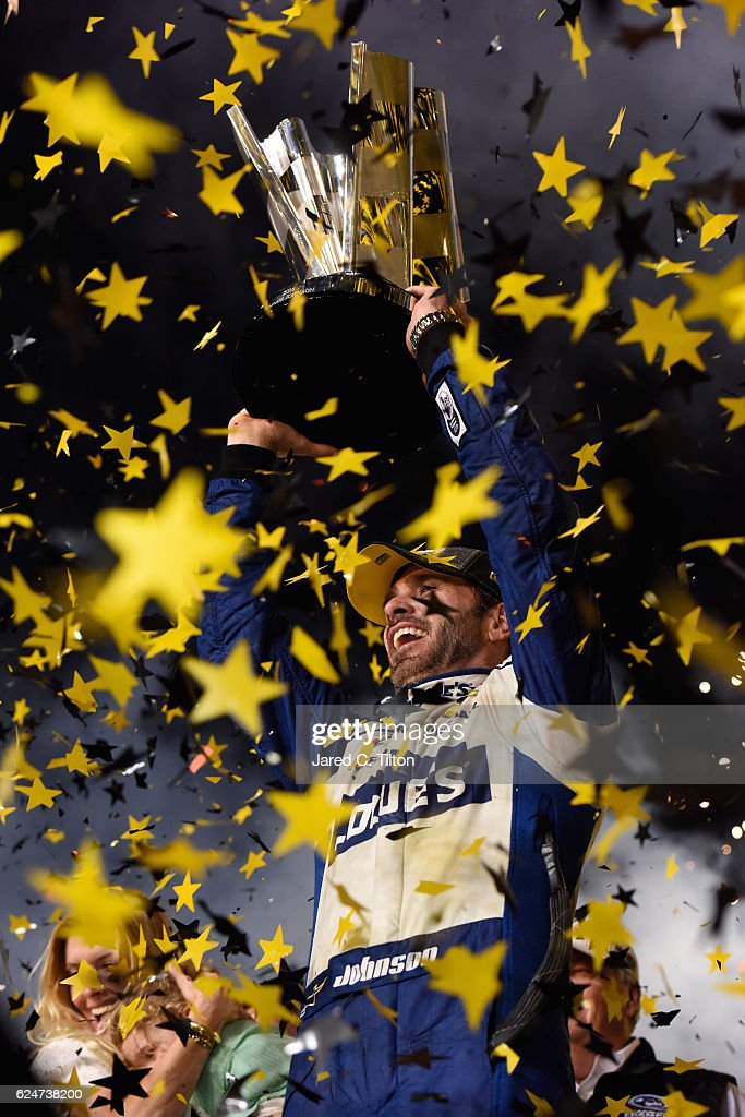 Jimmie Johnson, driver of the #48 Lowe's Chevrolet, celebrates with the NASCAR Sprint Cup Series Championship trophy in Victory Lane after winning the NASCAR Sprint Cup Series Ford EcoBoost 400 and the 2016 NASCAR Sprint Cup Series Championship at Homestead-Miami Speedway on November 20, 2016 in Homestead, Florida. Johnson wins a record-tying 7th NASCAR title.