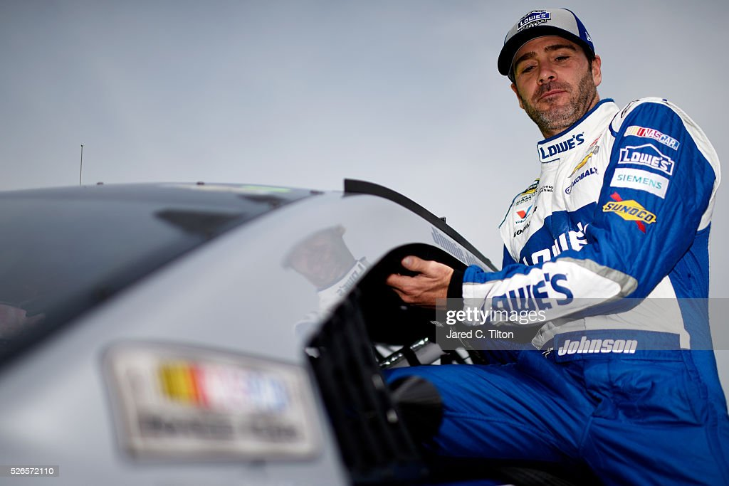 Jimmie Johnson, driver of the #48 Lowe's Chevrolet, Climbs from his car on the grid during qualifying for the NASCAR Sprint Cup Series GEICO 500 at Talladega Superspeedway on April 30, 2016 in Talladega, Alabama.