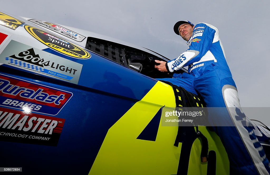 Jimmie Johnson, driver of the #48 Lowe's Chevrolet, climbs from his car during qualifying for the NASCAR Sprint Cup Series GEICO 500 at Talladega Superspeedway on April 30, 2016 in Talladega, Alabama.