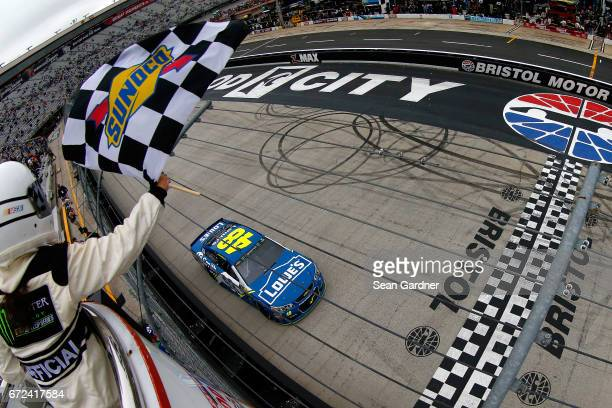 Jimmie Johnson driver of the Lowe's Chevrolet crosses the finish line to win the Monster Energy NASCAR Cup Series Food City 500 at Bristol Motor...