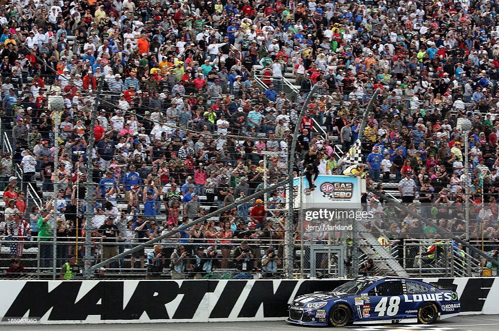 <a gi-track='captionPersonalityLinkClicked' href=/galleries/search?phrase=Jimmie+Johnson+-+Nascar+coureur&family=editorial&specificpeople=171519 ng-click='$event.stopPropagation()'>Jimmie Johnson</a>, driver of the #48 Lowe's Chevrolet, crosses the finishline to win the NASCAR Sprint Cup Series STP Gas Booster 500 on April 7, 2013 at Martinsville Speedway in Ridgeway, Virginia.