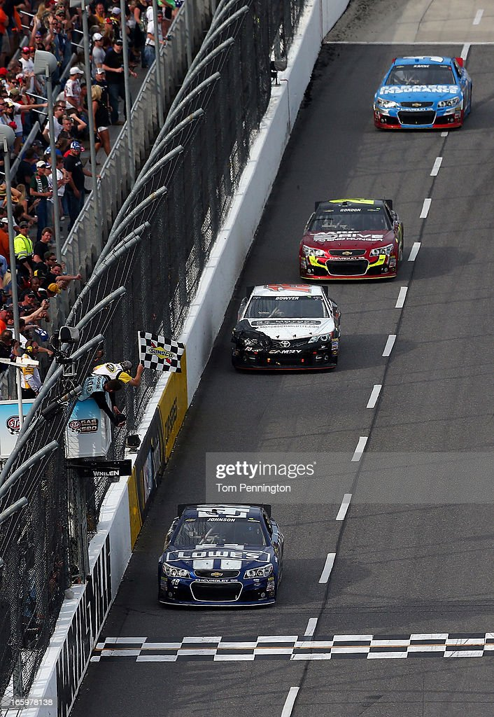 Jimmie Johnson, driver of the #48 Lowe's Chevrolet, crosses the finishline to win the NASCAR Sprint Cup Series STP Gas Booster 500 on April 7, 2013 at Martinsville Speedway in Ridgeway, Virginia.