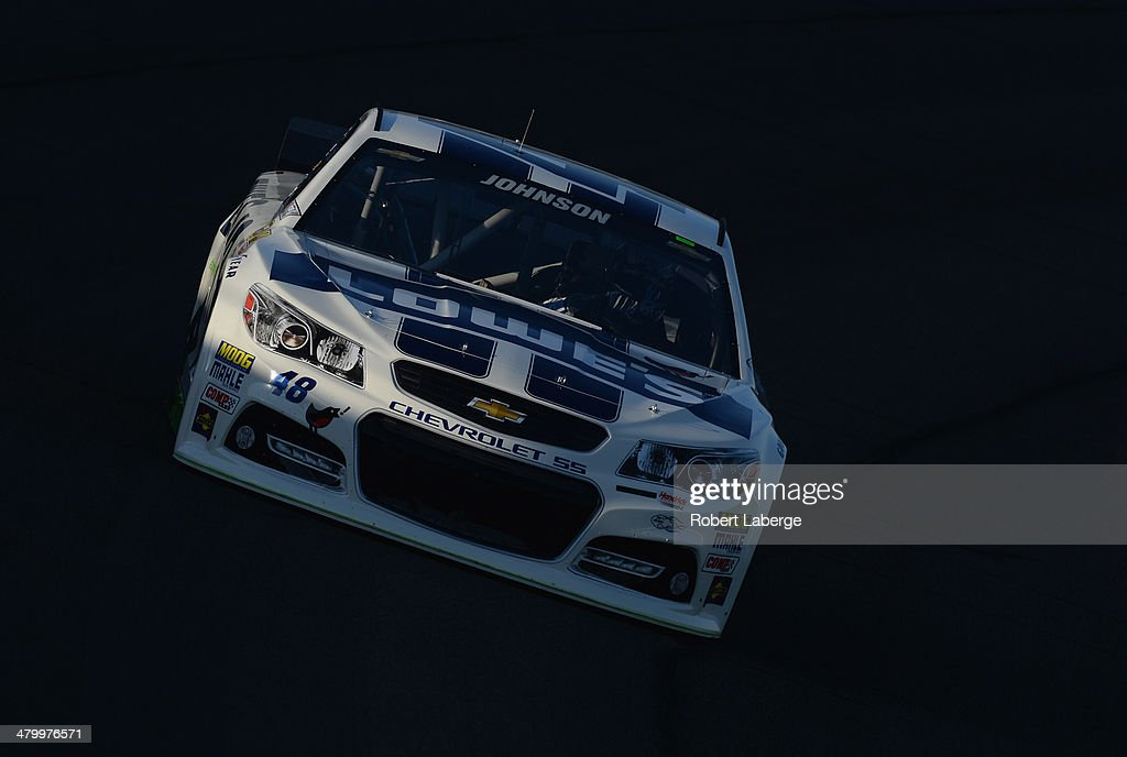 Jimmie Johnson, driver of the #48 Lowe's Chevrolet, drives during qualifying for the NASCAR Sprint Cup Series Auto Club 400 at Auto Club Speedway on March 21, 2014 in Fontana, California.
