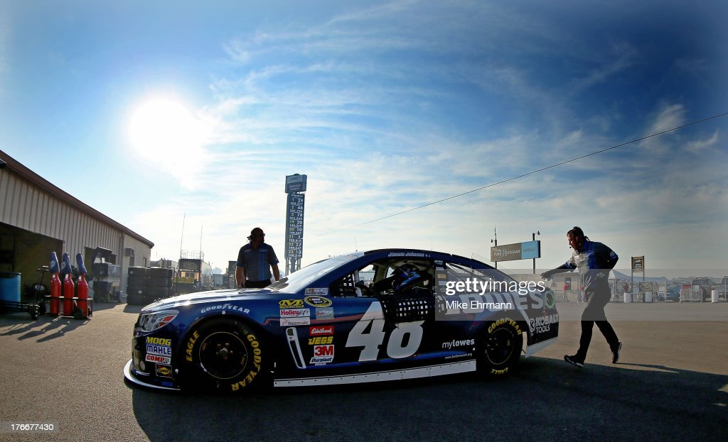 Jimmie Johnson, driver of the #48 Lowe's Chevrolet, drives in the garage area during practice for the NASCAR Sprint Cup Series 44th Annual Pure Michigan 400 at Michigan International Speedway on August 17, 2013 in Brooklyn, Michigan.