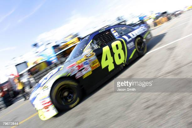 Jimmie Johnson driver of the Lowe's Chevrolet drives in the garage area during practice for the Budweiser Shootout at Daytona International Speedway...