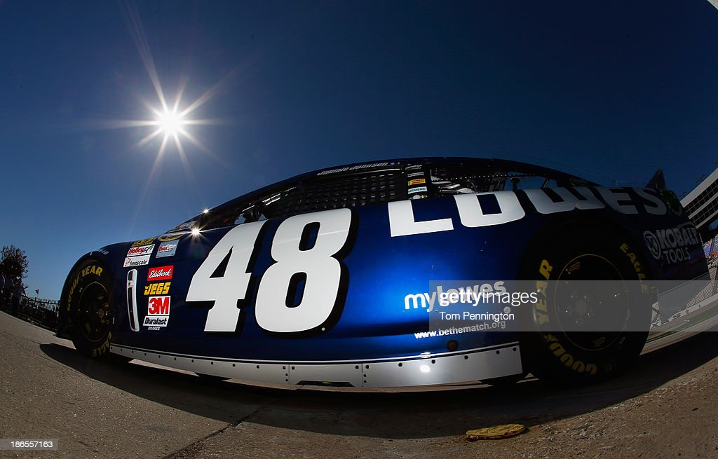 Jimmie Johnson, driver of the #48 Lowe's Chevrolet, drives through the garage area during practice for the NASCAR Sprint Cup Series AAA Texas 500 at Texas Motor Speedway on November 1, 2013 in Fort Worth, Texas.