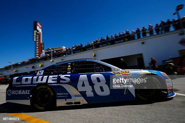 Jimmie Johnson driver of the Lowe's Chevrolet drives through the garage area during practice for the 57th Annual Daytona 500 at Daytona International...