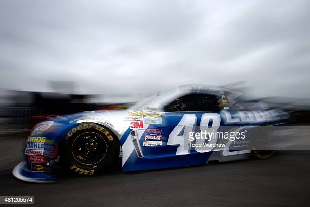Jimmie Johnson driver of the Lowe's Chevrolet drives through the garage area during practice for the NASCAR Sprint Cup Series 5Hour Energy 301 at New...