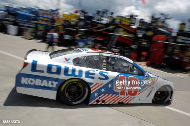 Jimmie Johnson driver of the Lowe's Chevrolet drives through the garage during practice for the Monster Energy NASCAR Cup Series CocaCola 600 at...