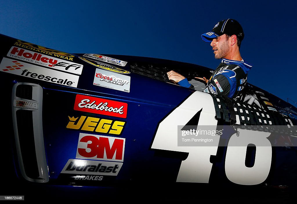 Jimmie Johnson, driver of the #48 Lowe's Chevrolet, gets in his car during qualifying for the NASCAR Sprint Cup Series AAA Texas 500 at Texas Motor Speedway on November 1, 2013 in Fort Worth, Texas.